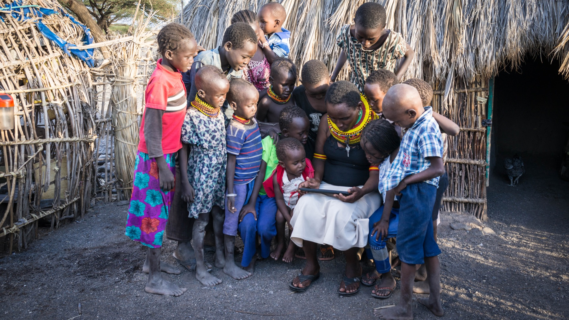 Barfoot teacher Veronica (Turkana) with kids of her village, 2016